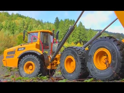 HEAVY RC CONSTRUCTION MACHINES! MACHINES IN THE MUD! COOL RC TOYS WORK AT THE BIG MINE! RC ACTION
