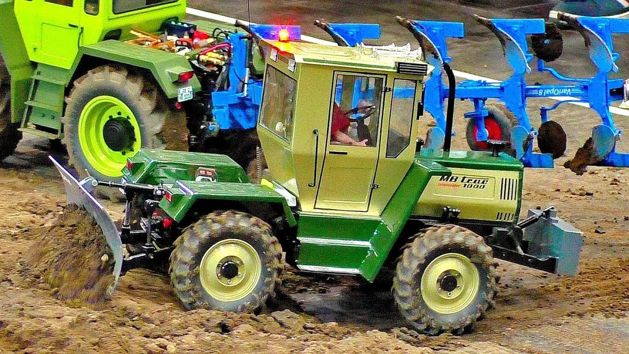 WONDERFUL RC MACHINE MODEL TRACTOR MB-TRAC 1000 TURBO WITH LEMKEN PLUGH AT HARD WORK ON A FIELD