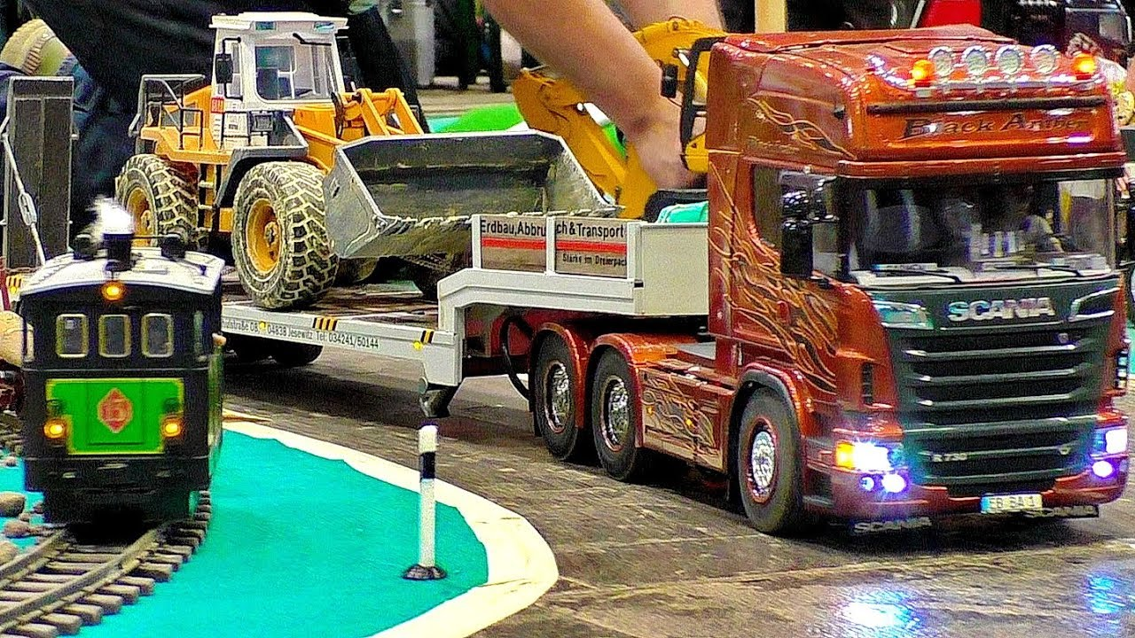 AMAZING DETAILS RC SCALE 1:16 MODEL TRUCKS IN MOTION ON A FANTASTIC PARCOUR