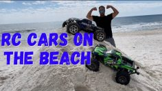 Rc cars on the beach. Traxxas Hoss & Revo catching air.